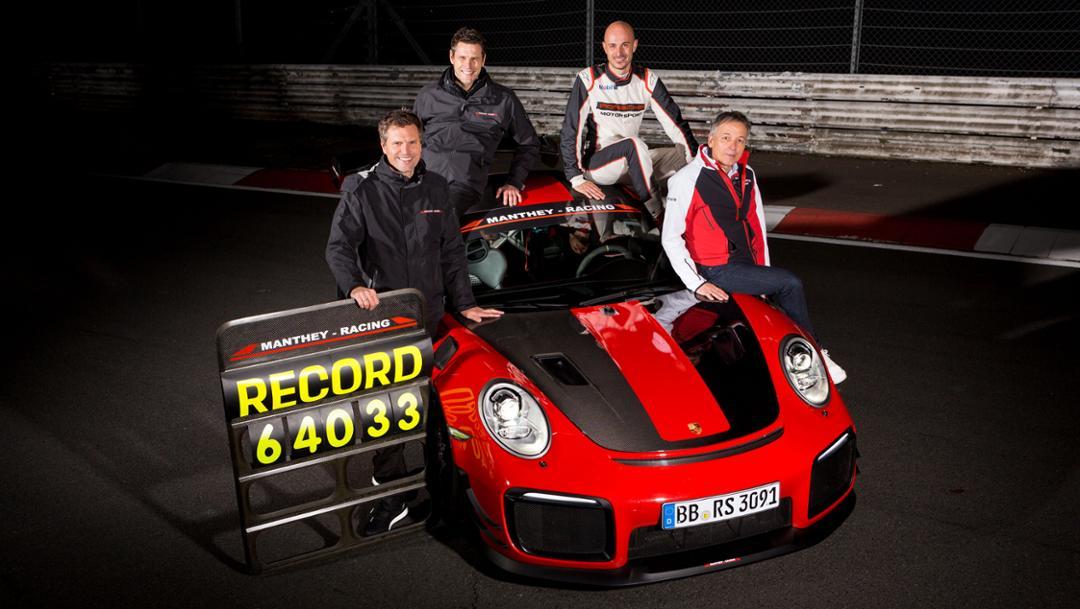 Martin Raeder, Nicolas Raeder (both CEO Manthey Racing), Lars Kern (Porsche growth driver), Eugen Oberkamm (Director Motorsport Complete Vehicle Engineering, l-r), 911 GT2 RS MR, Nürburgring-Nordschleife, 2018, Porsche AG