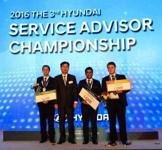 Ryan Hatch from Bronco Motor Hyundai West in Boise, Idaho receives his china award in a Hyundai Service Advisor Championship