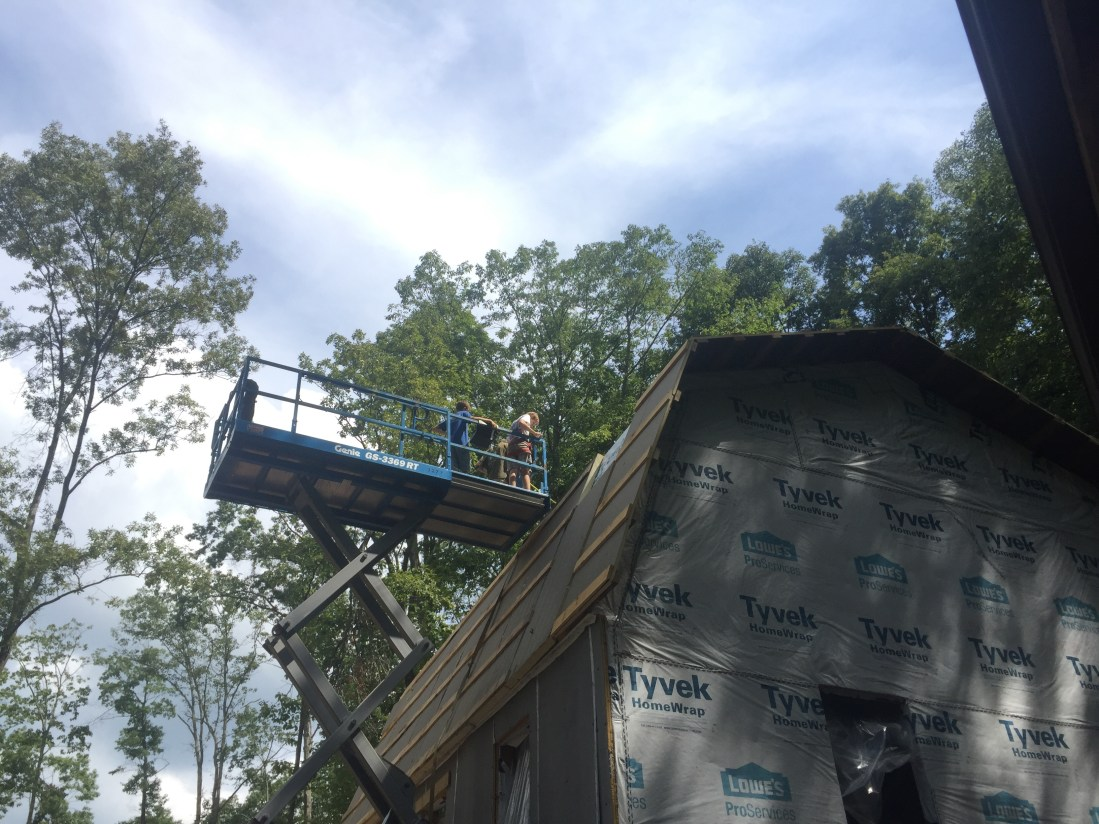 Scissor lift and gambrel roof cabin