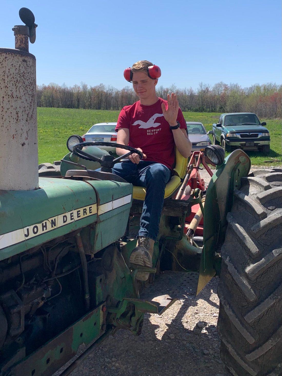 Teen on tractor