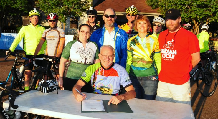 "Mayor Gene McGee signs proclamation declaring May as Bicycle Safety Month in Ridgeland. The proclamation from the Office of the Mayor states: ""I urge all residents as motorists or bicyclists to respect cycling and encourage safety throughout our community. Bicycling has a wide range of benefits for the cyclists as well as the community-at-large, including saving money and time, reducing traffic and improving health and fitness."" Signatures on the proclamation include William McKinley, Jackson Metro Cyclists; Jayce Powell, Ridgeland Bicycle Advocate; Melody Thortis, Executive Director, Bikewalk Mississippi; and Michelle Williams, Crooked Letter Cycling."