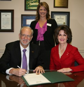 Mayor Gene McGee signed a Proclamation to recognize the importance of regular physical activity and proclaim April 1, 2015 as National Walking Day in Ridgeland. Pictured to his right, seated, is Jan Collins, American Heart Association volunteer, and standing, Jennifer Wellhausen, Vice President, Greater Southeast Affiliate of the American Heart Association.