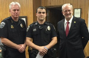 "Officer Jimmy Finnegan was selected as Officer of the Month for November, 2015. Chief Neal said, ""It is every Ridgeland Police Officer's job to protect the citizens of Ridgeland, and Officer Finnegan takes that responsibility seriously and is to be commended for his actions."" Pictured left to right: Chief John Neal, Officer Jimmy Finnegan, Mayor Gene McGee at a recent Mayor and Board of Aldermen Meeting."