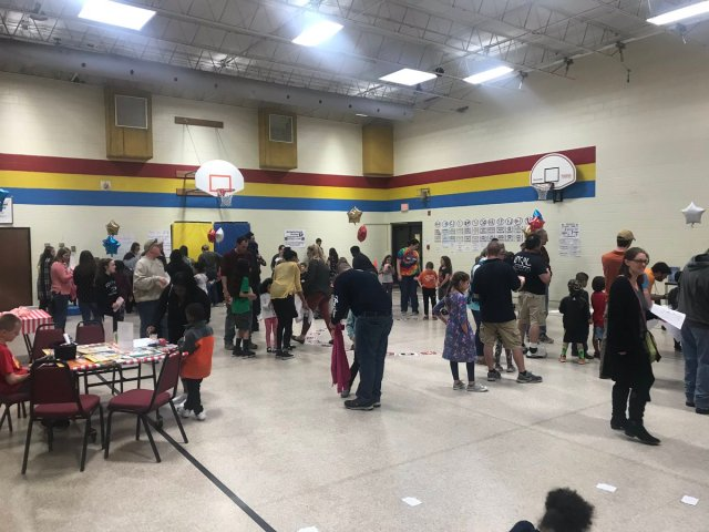 Gymnasium crowded with students and teachers at Math Carnival
