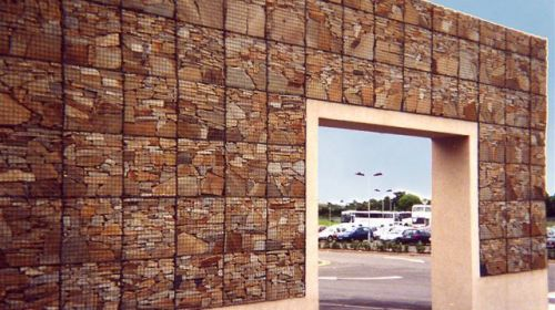 A front view of a free standing gabion wall