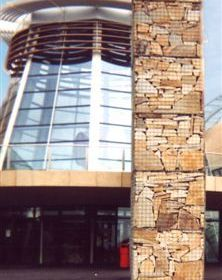 A side view of a free standing gabion wall
