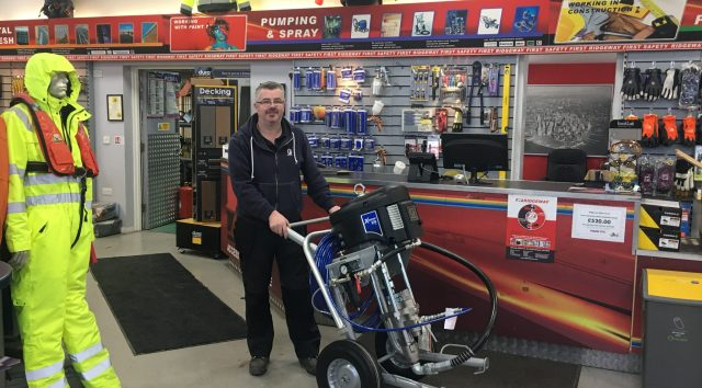 Ridgeway's Mark Murray with the Graco X70 spray unit tailored for Alternative Heat.