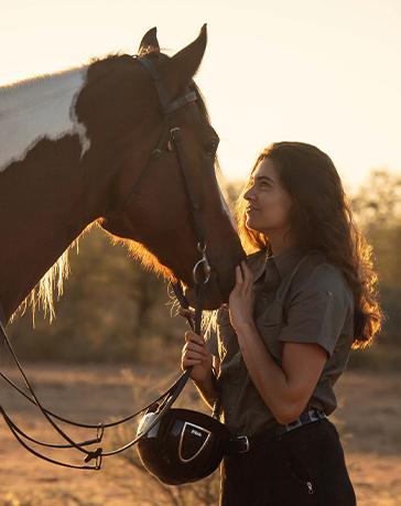 Rider stroking horse