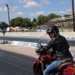 Leah on her motorcycle at the dragstrip