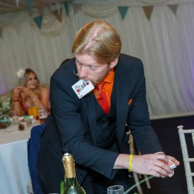 Frank performing close up magic at a wedding