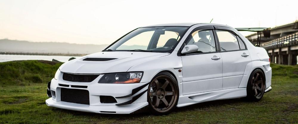 White modified Mitsubishi Evolution VIII