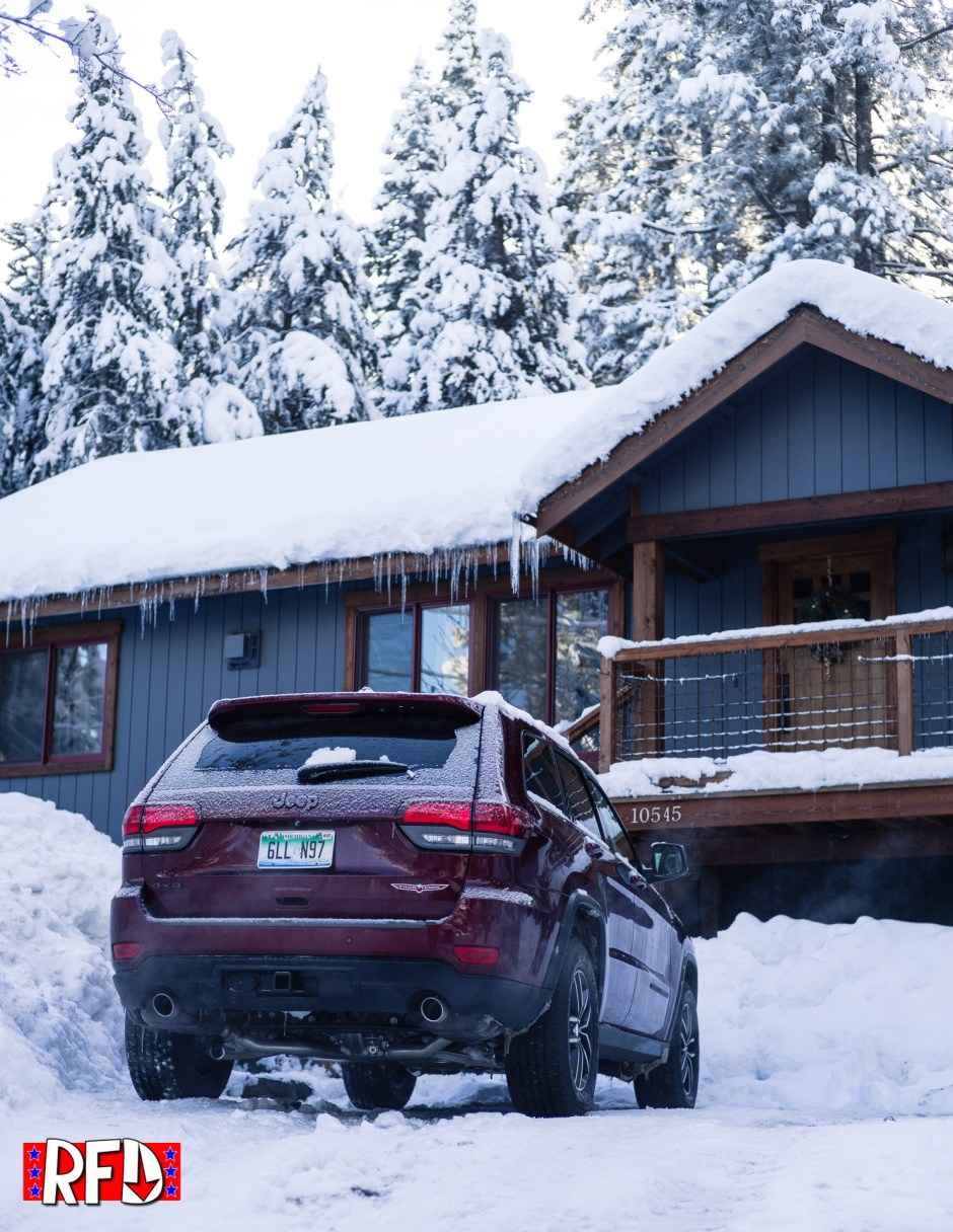 Jeep Grand Cherokee Trailhawk in snowy driveway
