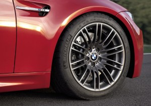Forged wheels and 2-piece rotors on a red E92 M3