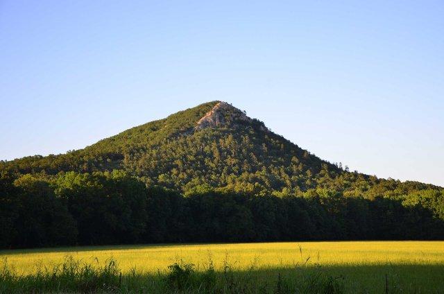 Pinnacle Mountain is shown from below