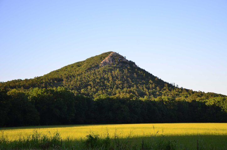 Pinnacle Mountain is shown from below