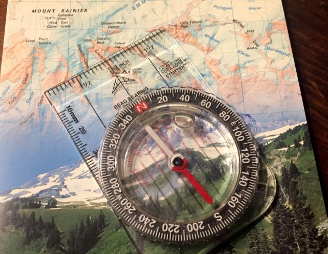 A picture of a compass and map