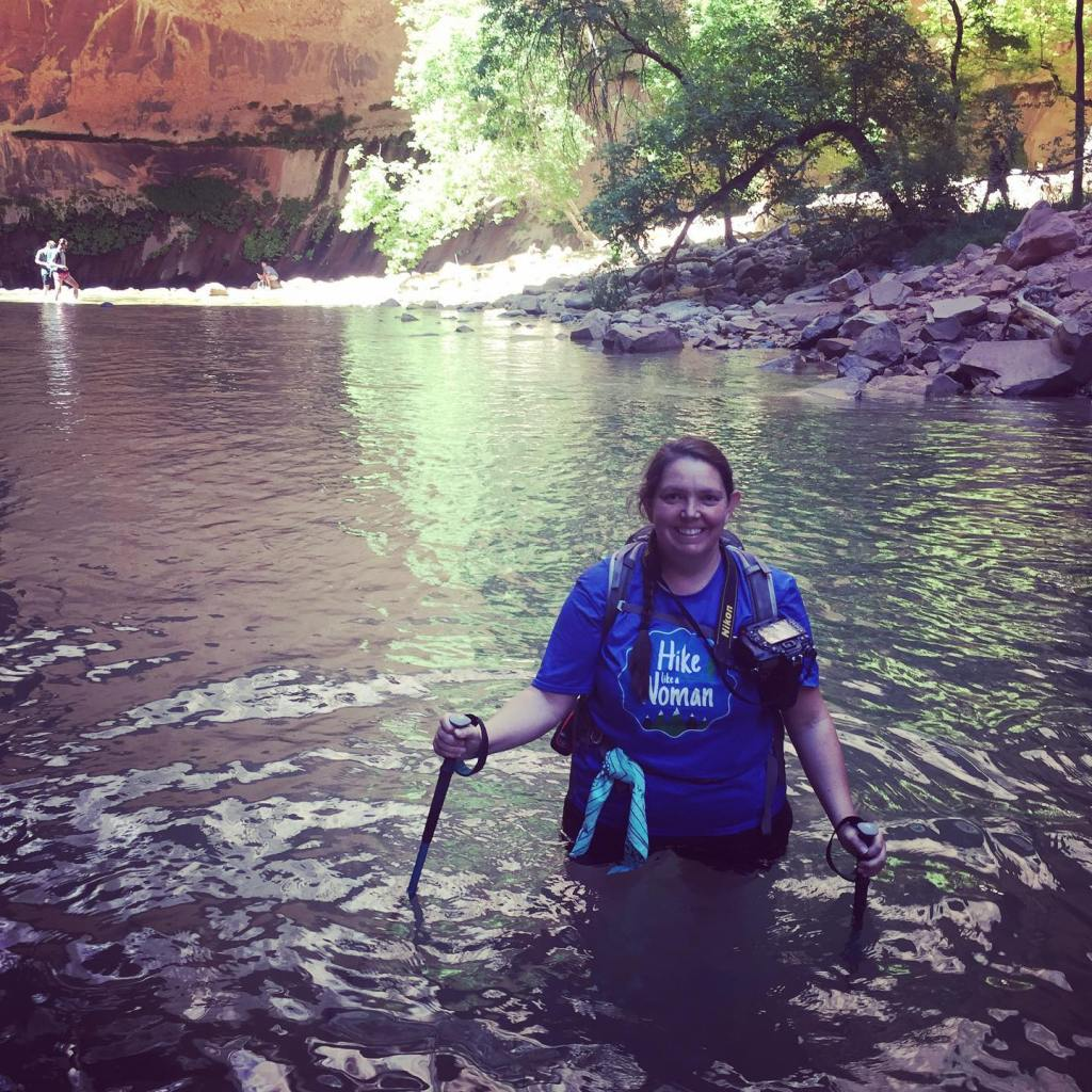 Standing nearly waist deep while day hiking The Narrows at Zion National Park