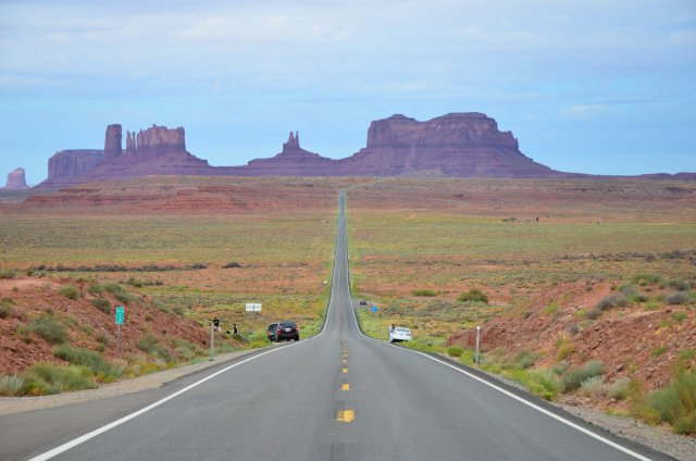 Vehicle are shown at Forrest Gump Point at Monument Valley Navajo Tribal Park