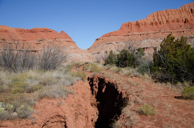A deeply cut wash is shown at Caprock Canyons State Park
