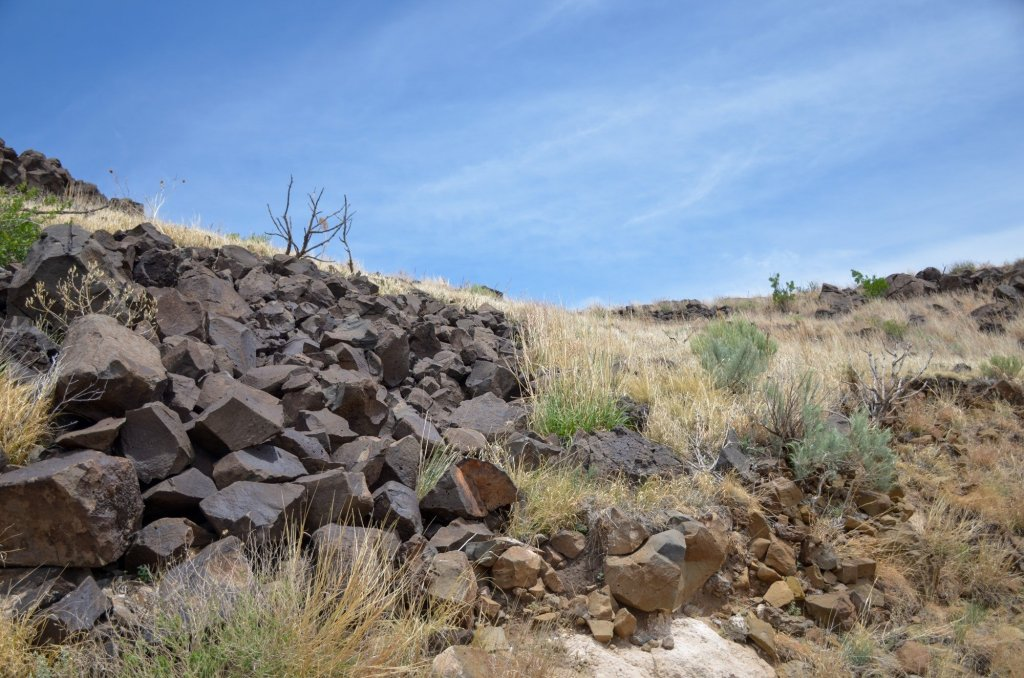 Black rocks are shown at Black Mesa State Park