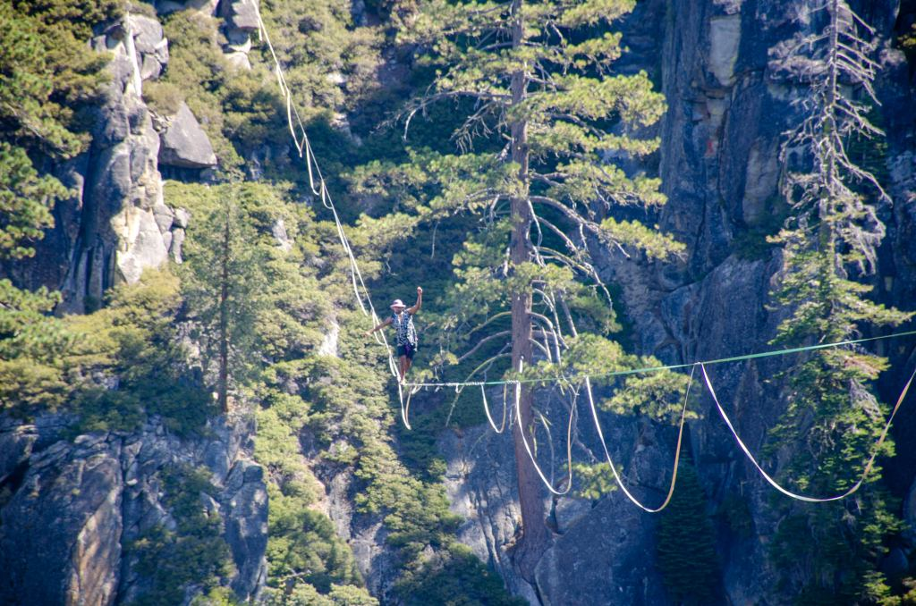 A slackliner makes his way across - One Day in Yosemite National Park