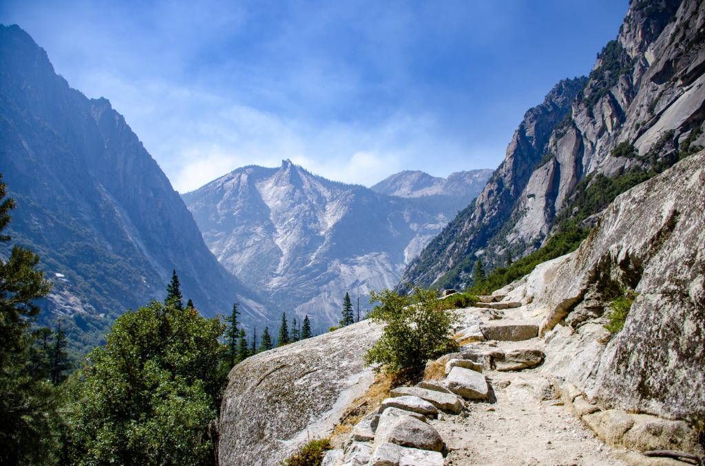 The view of the Sierra Nevada Mountains are shown on the trail to Mist Falls Kings Canyon National Park