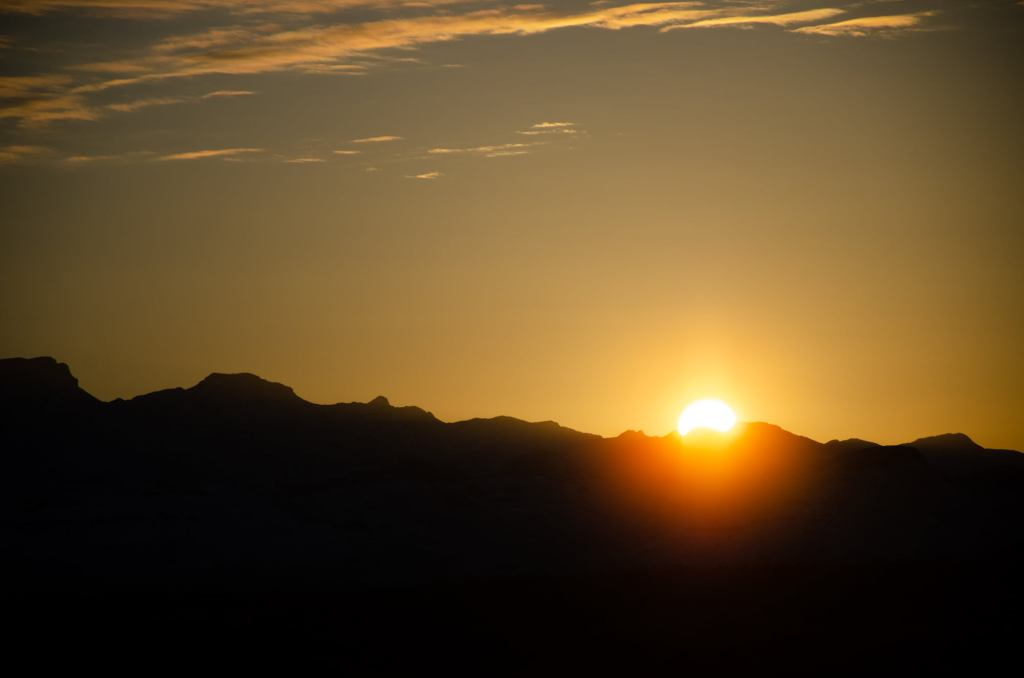The sun rises over the mountains in Terlingua Texas