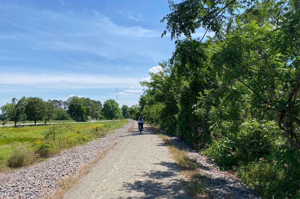 A woman bikes along the Delta Heritage Trail from Watson to Rohwer