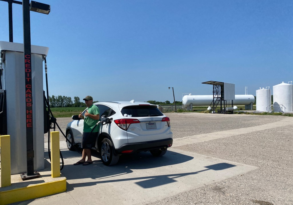 A man fuels up a car