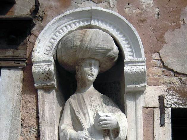 Turbaned figure in exterior wall niche,Campo dei Mori, Venice.