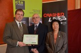 Bryan Myles CTA Consultancy - Keith Smith Training Manager St John Ambulance accepting certificate in regognition of valuable contribution to Road Safety in Northern Ireland - Anna Lo MLA