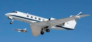 Landing alongside chase plane.   Note the difference in wing shape between the experimental Gulfstream and the traditional chase plane.  (Photo by NASA)