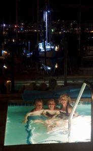 Silver Gate YC amenity, evening Jacuzzi in front of Kandu lit by her spreader lights.