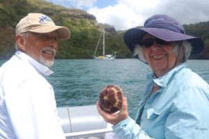 Ron & Rosie displaying one of the incredible urchin shells found in Taipi Vai.