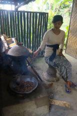 Hand roasting Lewak coffee beans.
