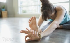 100844833-woman-in-seated-forward-bend-practicing-mudra-yoga