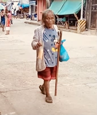 old lady walking with wooden cane