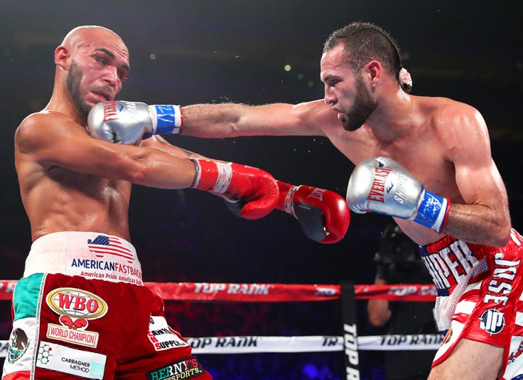 Jose Pedraza (right) en route to winning the WBO lightweight title against Raymundo Beltran. Photo credit: Mikey Williams/Top Rank