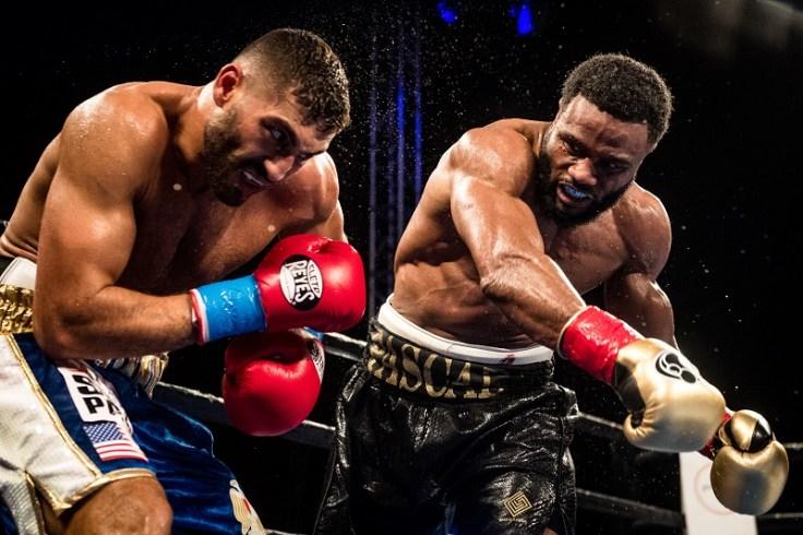 Jean Pascal (right) vs. Ahmed Elbiali. Photo credit: Douglas DeFelice/Premier Boxing Champions
