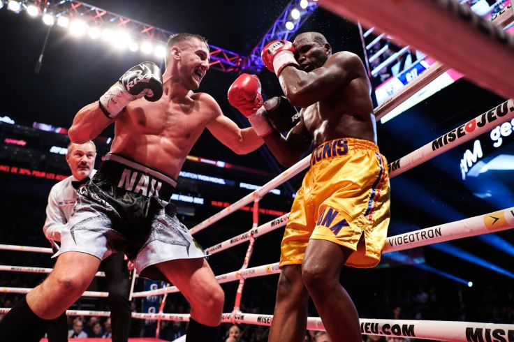 Oleksandr Gvozdyk (left) moves in on a stunned Adonis Stevenson to land his finishing punches. Photo by Amanda Westcott-SHOWTIME