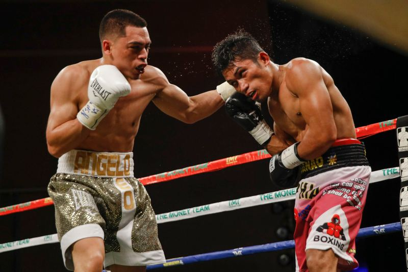 Angelo Leo (left) lands a left hook on Neil John Tabanao. Photo by Esther Lin/SHOWTIME