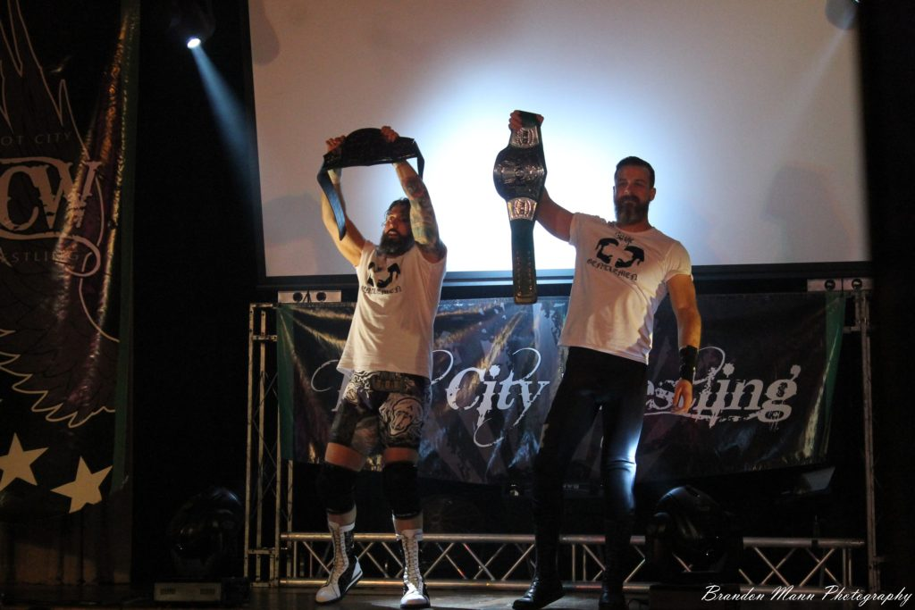 Brodie Marshall & Tyler Daniels holding the Tag Team Titles