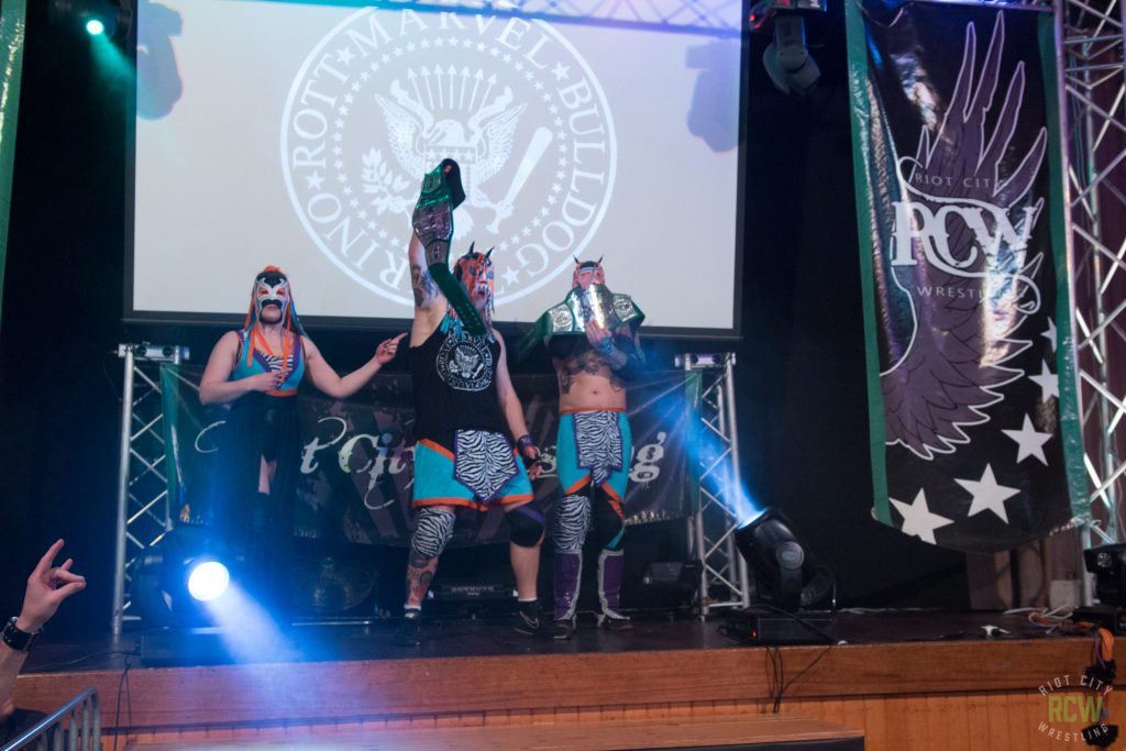 the Rude ones holding the RCW Tag belts