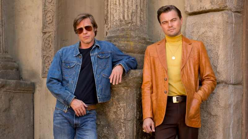 Leonardo DiCaprio and Brad Pitt in Once Upon A Time in Hollywood. A review of the film is at Riot Material, LA's premier magazine for art and film.