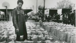 Bobby Seale Checks Food Bags. March 31, 1972.