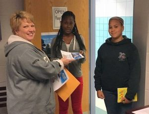 Audra Ely from Ripley's presents awards to Da'ljah Dickerson (center) and Kelis Sandifer (right)