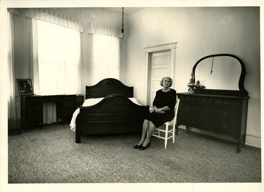 Mary Bledsoe sitting in the room she rented to Lee Harvey Oswald
