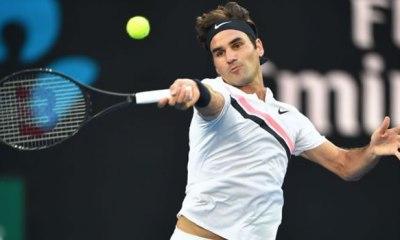 Federer begins defence of Australian Open title with win; Djokovic advances