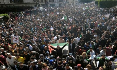 One dead, 63 wounded, 45 detained as protesters call on Algeria President to step down