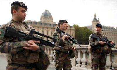 French security forces gun down knifeman who killed 4 officials in attack at police HQ